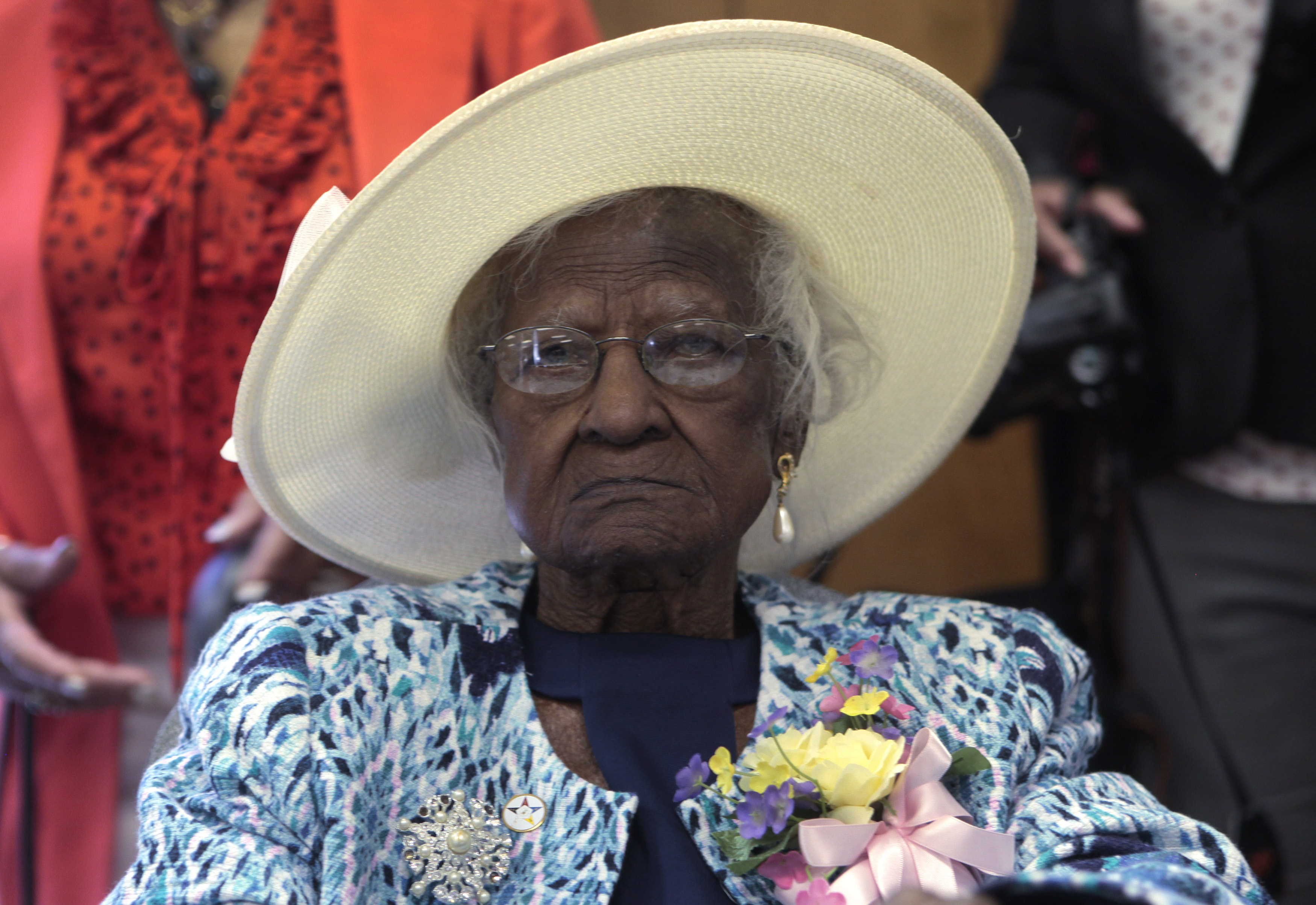Talley sits at the head table during a celebration of her 115th birthday at the New Jerusalem Missionary Baptist Church in Inkster