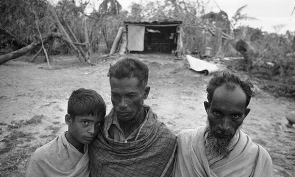 Rafiqul Islam, right, Nur Hussain Farati, center, and Farati?s sole surviving son, Abdul Kalam, left, pose in East Pakistan, Dec. 3, 1970. The skin on Rafiqul?s arms was rubbed raw as he clung to a tree during the storm which swept his two sons and an infant daughter to their deaths. The storm cost Nur Hussain seven members of his family, including his father and mother. (AP Photo/Harry Koundakjian)