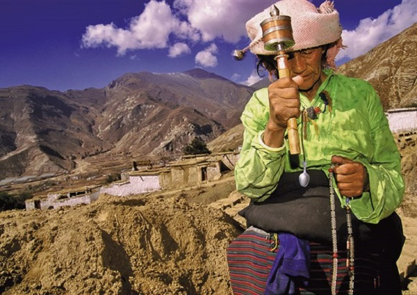 Woman w. Prayer Wheel, near Lhasa, Tibet1