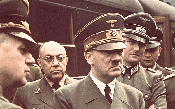 Theodor Morell (glasses) with Hitler.